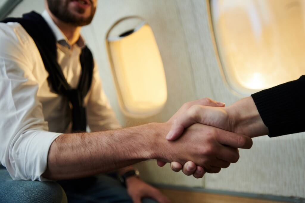 Photo of an exclusive magician on board a private plane with client